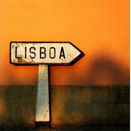 Sign pointing to Lisbon